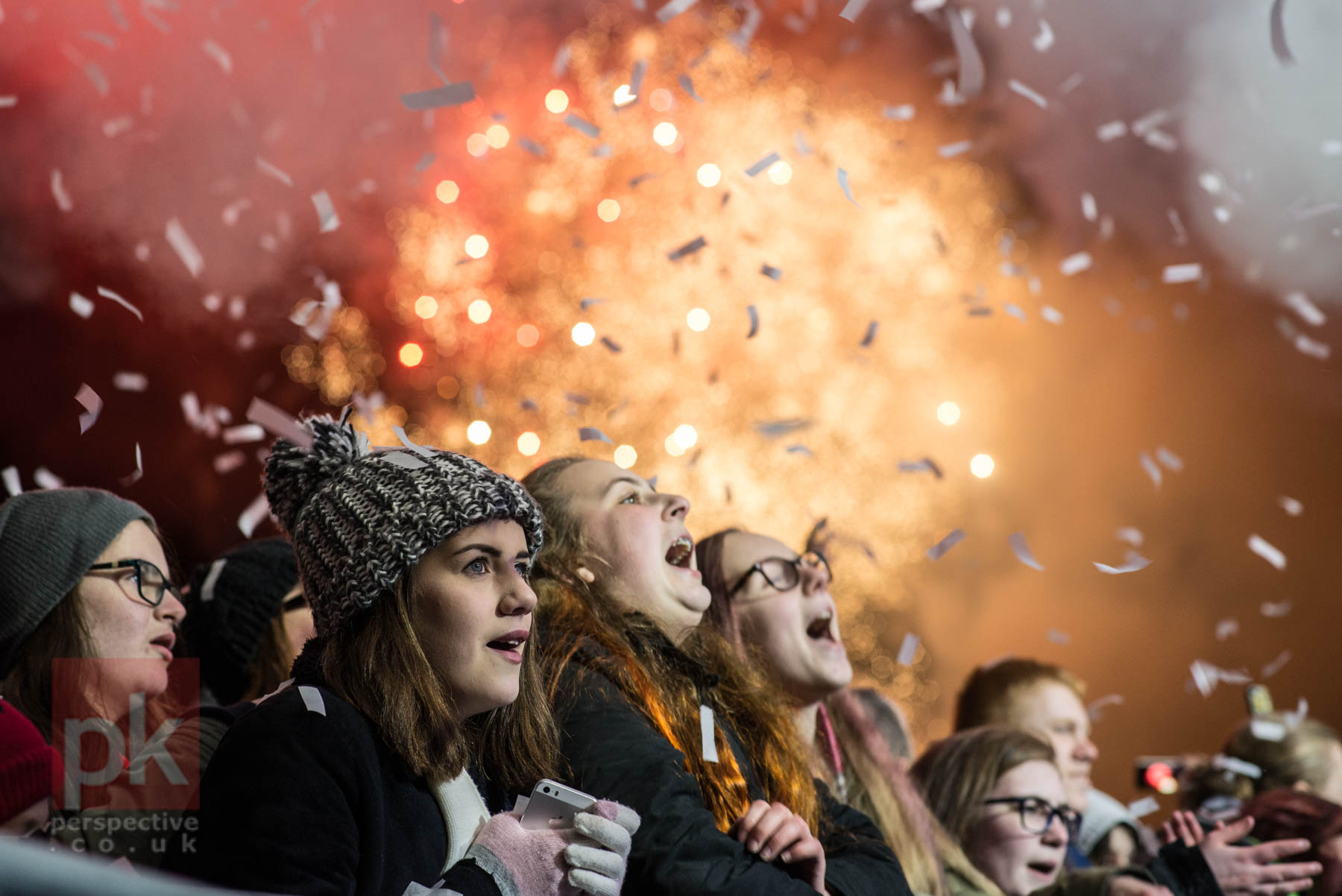 Locals singing away at the front of the main stage of the Christmas Light Switch On in Perth, with the fireworks and confetti cannon all going off at the same time.