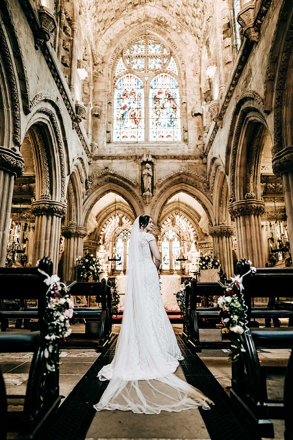 Rosslyn Chapel wedding photography featuring a bride inside the chapel