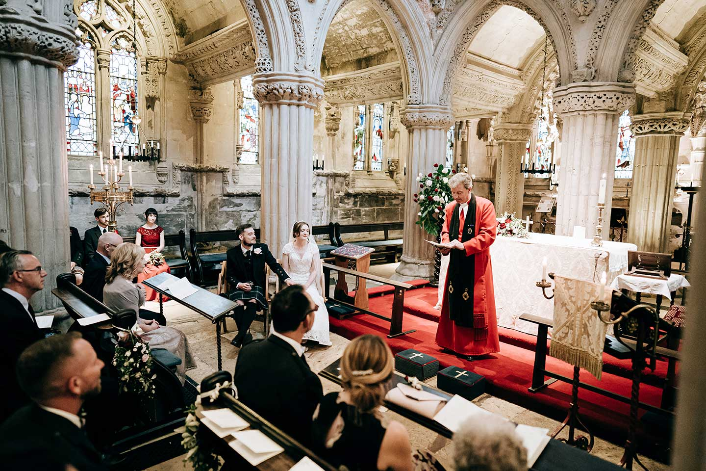 Inside Rosslyn Chapel during a wedding ceremony, Scotland Wedding Photograpy